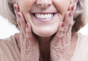 Elderly woman in dentures